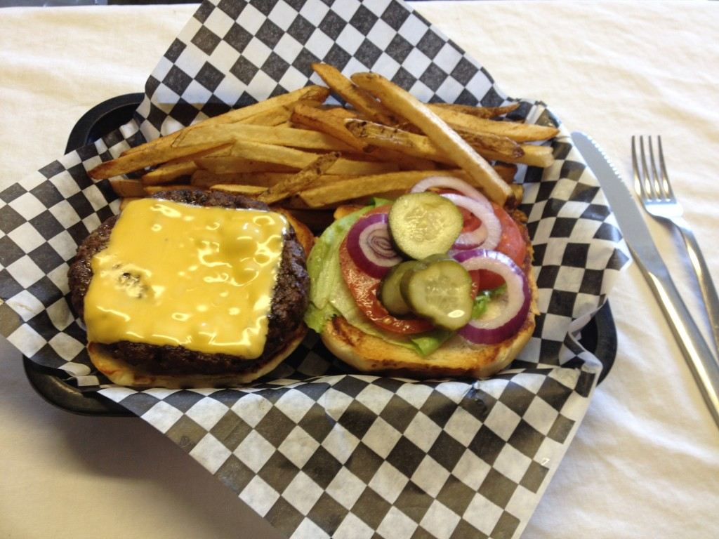 ozark burger with cheese and fries